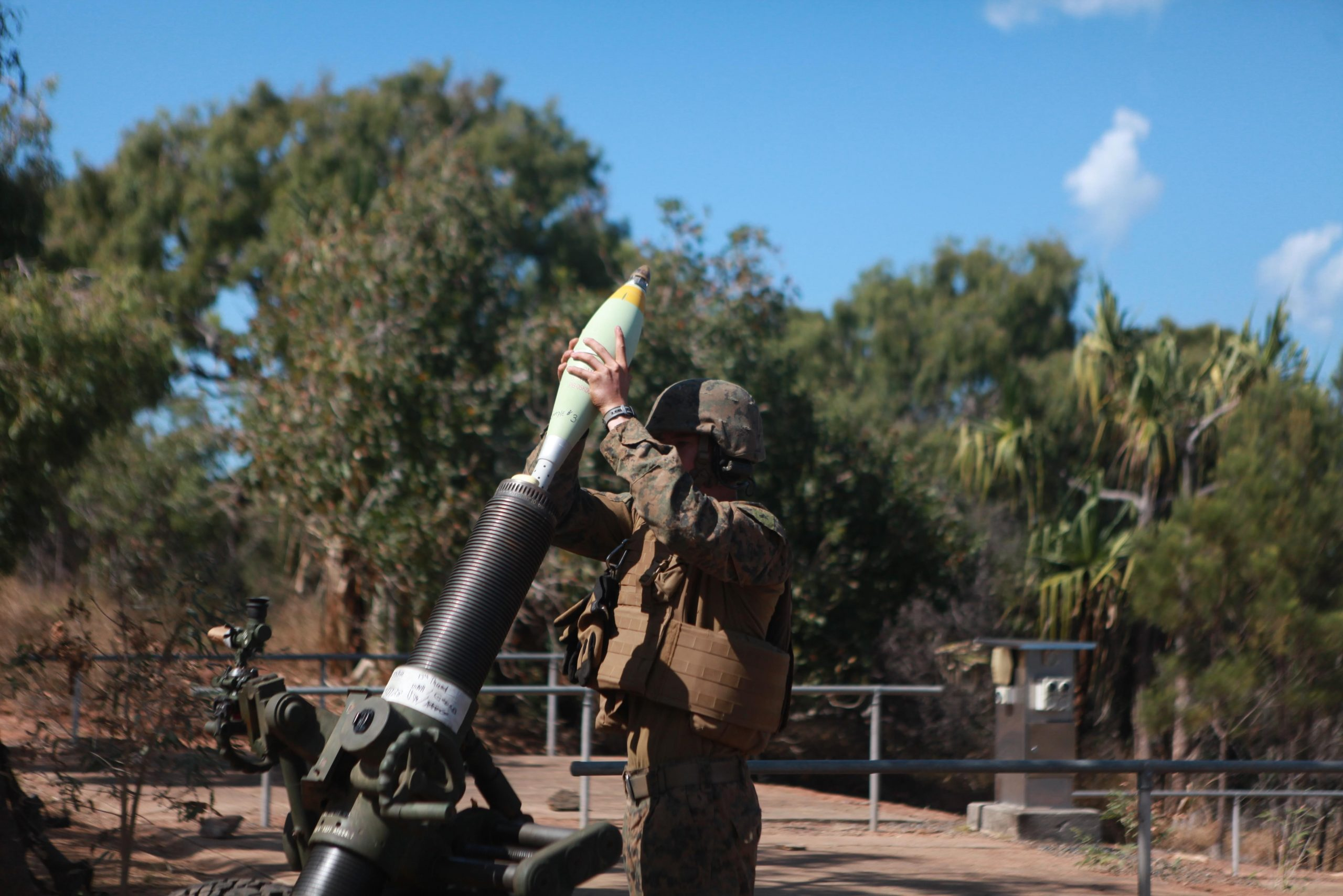 A Marine with the 120mm mortar platoon for Echo Battery, Battalion Landing Team 2nd Battalion, 4th Marines, 31st Marine Expeditionary Unit, loads a round into an M327 120mm mortar during a combined artillery and close air support training exercise following the conclusion of Talisman Saber 2013 here, Aug. 3. The live-fire exercise provided effective and intense training to ensure Australian and U.S. forces foster and sustain cooperative relationships that enhance regional security, stability and prosperity. The 31st MEU is the Marine Corps' force in readiness for the Asia-Pacific region and the only continuously forward-deployed MEU.