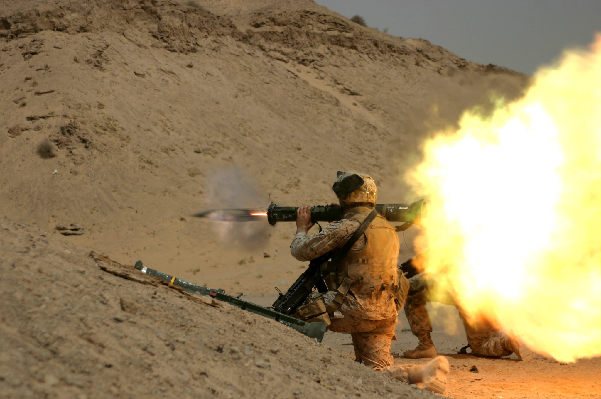 050718-M-1195M-121  Marine Lance Cpl. Gary R. Nichols fires an AT-4 light anti-armor weapon at an old tank during fire and maneuver training near Camp Bucca, Iraq, on July 18, 2005. Nichols and his fellow Marines of the 26th Marine Expeditionary Unit (Special Operations Capable) are operating out of Camp Bucca to conduct various force protection missions.  DoD photo by Cpl. Eric R. Martin, U.S. Marine Corps.  (Released)