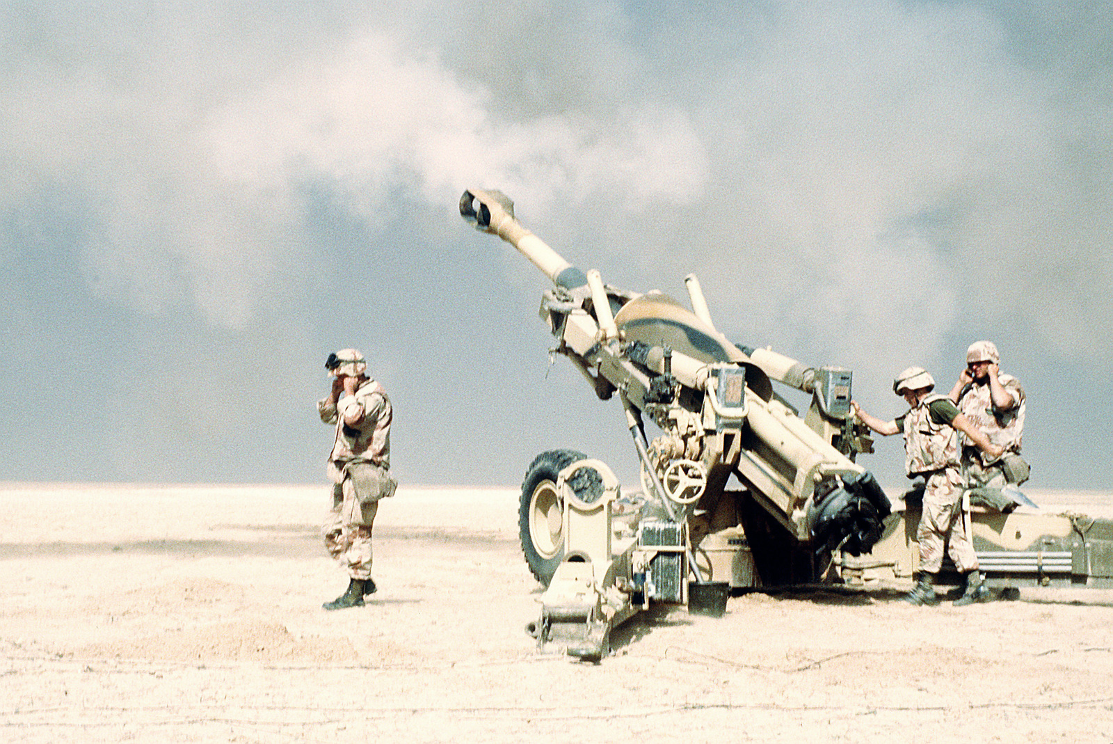 Marine artillerymen from the 2nd Marine Expeditionary Force fire their M-198 155mm howitzer in support of the opening of the ground offensive to free Kuwait during Operation Desert Storm.
