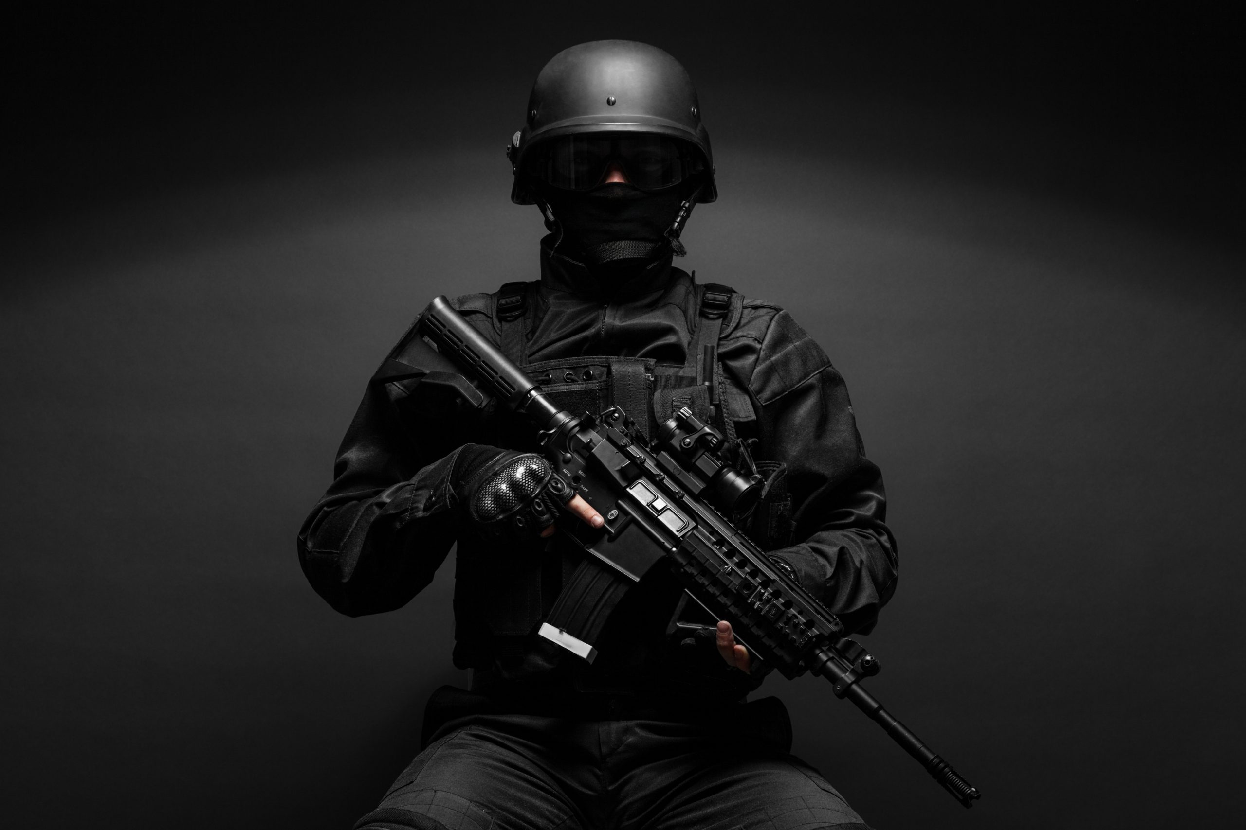 http://www.dreamstime.com/royalty-free-stock-photography-police-officer-weapons-spec-ops-swat-black-uniform-studio-image60987557