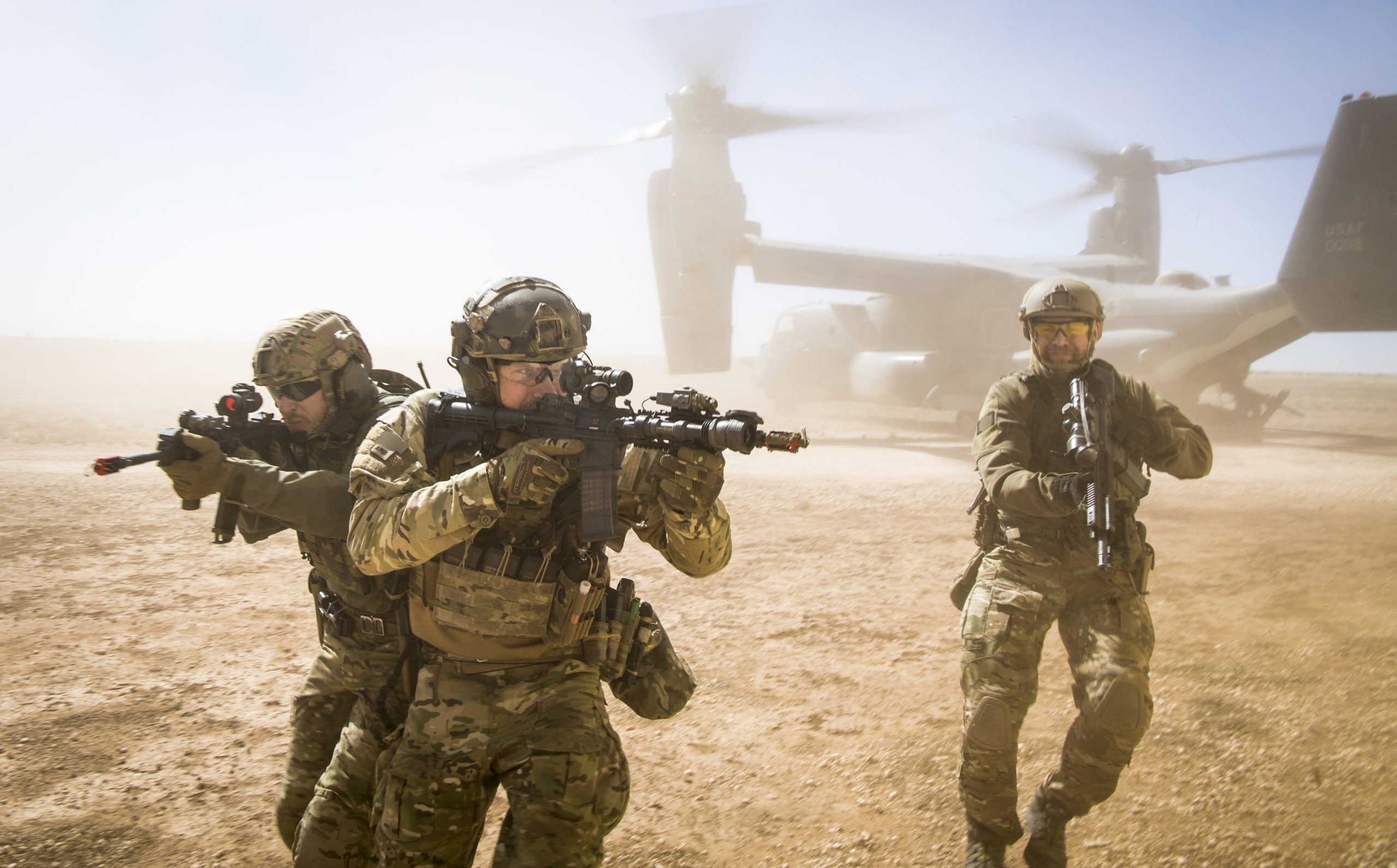 A joint special forces team move together out of a U.S. Air Force CV-22 Osprey Feb. 26, 2018, at Melrose Training Range, New Mexico. At Emerald Warrior, the largest joint and combined special operations exercise, U.S. Special Operations Command forces train to respond to various threats across the spectrum of conflict. (U.S. Air Force photo/Senior Airman Clayton Cupit)